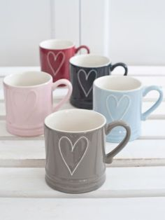 Heart Coffee Mugs - Nordic House, i wish i could find these in the USA <<< such an easy DIY, could even hot glue the heart and paint over it