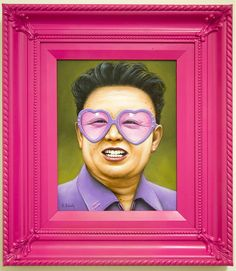 """Portraits by Florida-based artist Scott Scheidly are """"a series of 'fabulous' depictions of tyrants, dictators and popes."""" Each portrait is framed in hot pink, including one of Chairman Mao"""