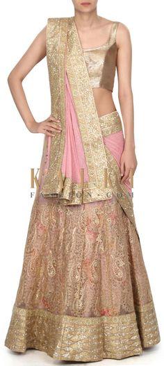 Buy this Creamy pink semi stitched lehenga embellished in zari only on Kalki