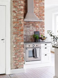 exposed brick wall in the kitchen interior Brick Wall Kitchen, Kitchen Decor, Kitchen Ideas, Kitchen Soffit, Kitchen Nook, Kitchen Inspiration, Kitchen Island, Küchen Design, House Design