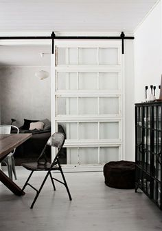 Sliding glass door. I love this style of doors. Similar to the sliding barn door idea..