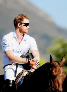 Prince Harry plays in the Sentebale Royal Salute Polo Cup at Val de Vie Estate during an official visit to Africa in Cape Town, South Africa | November 28, 2015