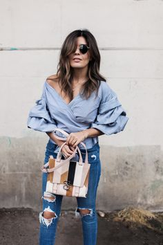 21 Genius Summer 2016 Outfit Ideas to Steal: A Shoppable Guide | 'Style MBA' blogger wearing a ruched sleeve wrap blouse with distressed denim