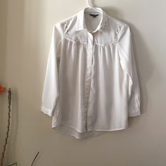 American Eagle Outfitters Blouse White silky button down with stud details on the collar and on the yoke area of the shirt. Excellent condition American Eagle Outfitters Tops Button Down Shirts