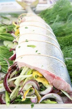 Whole Cooked Yellowtail with fennel, parsley, zests of lemon and red onion
