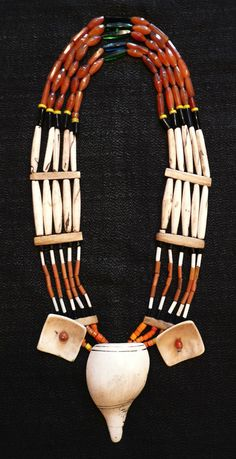 * Carved conch shell, bone, carnelian and glass beads. length 48 cm Nagaland early 20th century