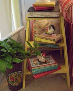 Yellow stepladder as a side table
