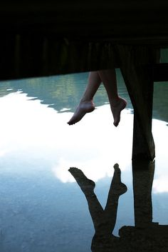 A crystalline lake. Legs dangling from the dock. It was all very idyllic until her toes touched moss.