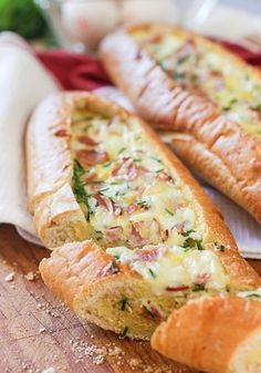 Baked Egg Boats. 2 small baguette, 6 eggs, ¼ cup half and half or whole cream, ½ cup ham (cut into cubes), ½ cup grated cheese, 2 tablespoons chopped chives or green onions