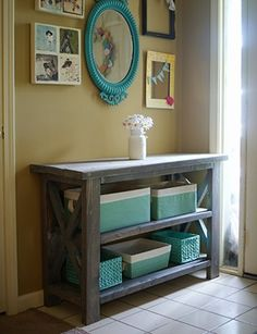 Love this entry and the use of Pantone's Hemlock green in the baskets and mirror. Practical storage with a pop of color!