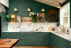 Dark green DeVol kitchen with dark green countertops and gold finishes, marble c. - Dark green DeVol kitchen with dark green countertops and gold finishes, marble countertops, and woo - Dark Green Kitchen, Green Kitchen Cabinets, Brass Kitchen, Kitchen Hardware, New Kitchen, Brass Hardware, Kitchen Backsplash, Kitchen Ideas, Kitchen Cabinetry