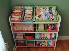 Shoe rack and plastic boxes make a great DIY organizer of an infant.