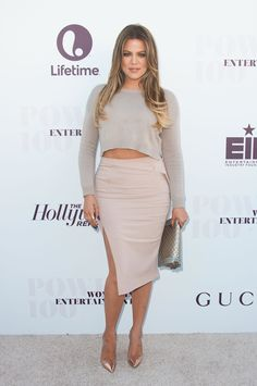 She wears a crop top in an ultra-light gray hue paired with a dull pink pencil skirt with an elevated slit.   - MarieClaire.com