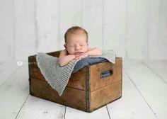 Newborn photo - cute angle of crate