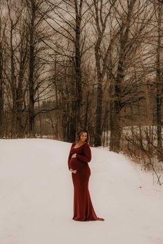 Winter maternity pictures in the snow. #SexyMamaMaternity #ShopSexyMama Winter Maternity Pictures, Winter Maternity Outfits, Maternity Gowns, Burgundy Gown, Classic Elegance, Simple Elegance, Elegant Dresses, Snow