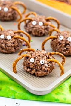 """These creative Rice Krispie Treat Spiders are a quick and easy Halloween treat made with Cocoa Krispies cereal, marshmallows, butter, and pretzels. They are fun, yummy, and just a little bit creepy too. Perfect for Halloween parties and celebrations! Get the kids in the kitchen to help make these kid-friendly Halloween Rice Krispies Treats. They can help stir the ingredients together, roll the treats into balls, and place the eyes and """"legs"""" on the spiders."""