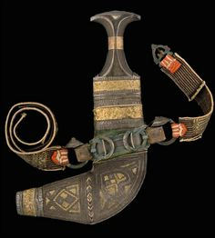 A JAMBIYYA WITH GILT DECORATED SHEATH, YEMEN, LATE 19TH-EARLY 20TH CENTURY