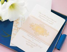 Elegant- classic colors, fancy font, and belly band make this invitation formal