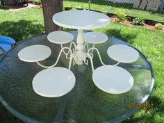 """Found via craigslist: """"Cake stand made with a chandelier. Gut chandelier down to the frame, spray paint white then spray w/laminate shine. Small circles are 7 in., large circle is 11 in. Great for birthday parties, weddings, baby showers."""" Can be used for cake, cupcakes, appetizers, etc. Definitely need to make something like this!"""