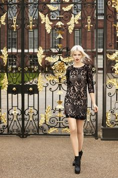 black and gold filigree. Black lace dress.