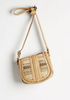 Rest Stop Shopping Bag. Browsing for souvenirs, you only consider items that coordinate with your tan purse!  #modcloth
