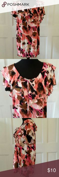 PRICE REDUCED LADIES TUNIC BY NEW DIRECTIONS WOMAN 2X DESIGNED IN A BEAUTIFUL ROSE, CREAM, BROWN AND BLACK WITH A SOFT V NECK WITH DOUBLE RUFFLES AND SHORT RUFFLED SLEEVES. THE BOTTOM OF THE TUNIC HAS A NICE ELASTIC BAND SO YOU CAN DECIDE IF YOU WISH TO WEAR IT AT THE WAIST, FURTHER DOWN ON THE HIPS, OR COMPLETELY OVER THE HIPS. GREAT WITH LEGGINGS. 95% POLYESTER 5% SPANDEX,  MACHINE WASH COLD. new directions Tops Tunics