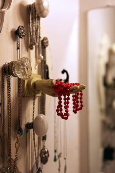 DIY Jewelry Holder -- another way to utilize knobs and create an interest wall in your closet or bedroom that is functional! Vintage all the way