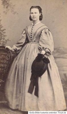 CDV Woman in Victorian Dress Bonn Germany 1860s   eBay.  Pretty simple trim.