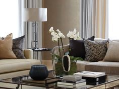 fabulously stylish coffee table display (vignette) of orchids artefacts and books Villa, Kuwait