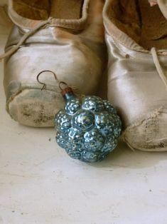 Could do one with a couple of ornaments in front of a pair of dressy holiday heels. Or with a pair of cozy slippers....
