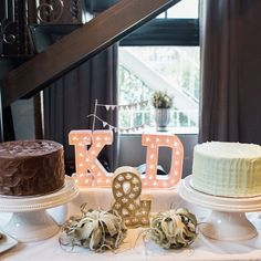 How sweet is this dessert table setup for an intimate wedding? His and hers cakes! :) Photo by @caseybrodley by budgetsavvybride