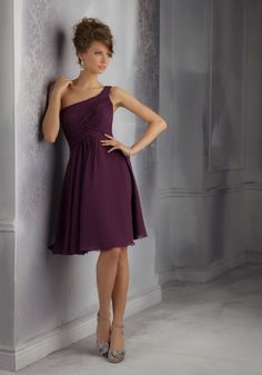 Asymmetrically Ruched and Draped Chiffon Bridesmaid Dress. Designed by Madeline Gardner. Zipper Back. Shown in Eggplant.