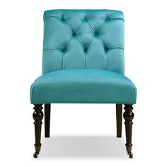 Blue Class. The Poppy accent chair's luscious blue velvet upholstery feels deliciously plush and pops against luxurious, turned front legs. The languidly rolled back with tailored, gathered pleating and deep button-tufting gives a healthy serving of glamour. Use the Poppy as a dining chair or in your living room as an accent chair.   A web-exclusive product. Item is not displayed in store, but may be ordered there.