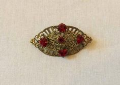 Art Deco Gold Tone Filigree Brooch With Red Diamantes - 1930s by LouisaAmeliaJane on Etsy