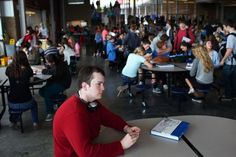Nick Eveland, 19, sits in the Glacier Peak High School cafeteria on yearbook day, May 31. Before his junior year at Glacier Peak, sitting in a crowded room would have been extremely difficult for Nick, who has autism.