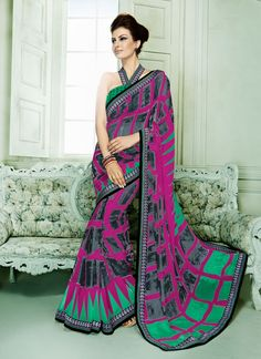 An exceptional deep gold color and eggplant hot pink georgette casual saree will make you appear highly stylish and graceful. You will see some interesting patterns done with lace and print work.  Com...