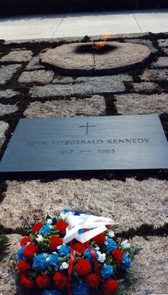 John Fitzgerald Kennedy 35th United States President. 1917 - 1963 - Headstone in Arlington National Cemetery Black Granite Flush marker set in pink granite pavers with eternal flame.