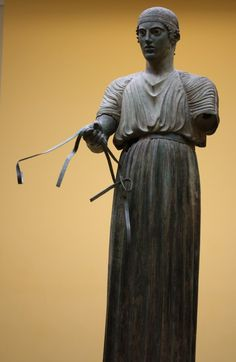 The Delphi Charioteer. (480-460 BC). (Photo taken by Mark Cartwright at the Archaeological Museum of Delphi). -- Ancient History Encyclopedia
