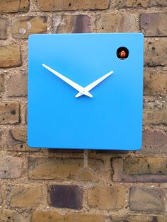 Modern blue cuckoo clock with pendulum