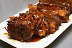 This slow cooker beer braised short ribs recipe produces the most tender, fall off of the bone ribs that you'll ever eat. Here's the easy recipe for you!