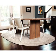 Enhance the look of any room with the Hand-woven Oval Kerala Ivory Jute Rug. This rug features a classic oval design with a durable braided construction and a stylish neutral ivory color that is sure to look great anywhere.
