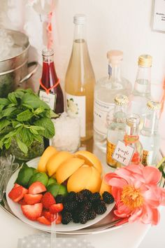 Serve yourself gin and tonic bar. Add fresh fruit, herbs and flowers for a natural pop of color! @helen4465