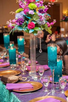 Gorgeous purple and teal wedding reception decor; Desi Wedding; Indian Wedding Reception; Hyatt Regency Wichita Kansas; Walter's Flowers & Interiors; Chasing Sky Photography
