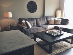 Living room - grays and dark browns with silver accents