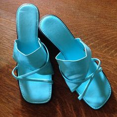 "Italian Turquoise sandals, made in Italy Very comfy sandals with stretchy fabric band. 2 1/4"" high wedge heel. Very good condition. Tiny bit of wear on right toe (where I once stubbed my toe 😬) - not very noticeable. Made in Italy by ""Italian"" brand. From smoke free home. Italian Shoes Sandals"