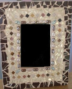 Chocolate Brown Mosaic Mirror - It has broken china pieces, flat marbles and stained glass.