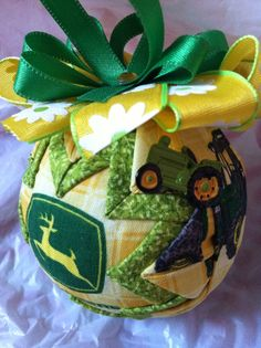diameter ornament made with John Deere print fabric and accented with green fabric. This ornament is topped with green and yellow ribbon. It also has a little tractor charm on one side. Great gift for the John Deere fan! Quilted Fabric Ornaments, Quilted Christmas Ornaments, Christmas Tree Themes, Handmade Christmas, Christmas Crafts, Redneck Christmas, Christmas Balls, John Deere Crafts, Ornament Crafts