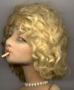 Lenci Smoker doll. Now I know there is a whole category of dolls known as Boudoir Smokers. Flappers, clearly.