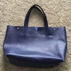 ✨Vince leather tote ✨ Indigo colored like new Vince tote! Reposh- love this but never used as it was too big for my purposes. Great quality real leather with raw suede interior. No marks, bag came to me with a small crease above the Vince logo. Not noticeable when wearing. This beautiful style is full price in stores currently! Great deal! Vince Bags Totes