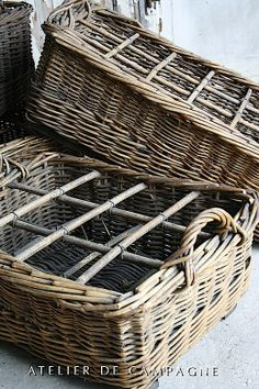 Wicker baskets with some beautiful clear and blue bottles in it, that would be beautiful